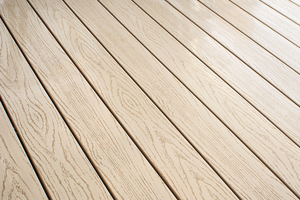 Vinyl deck material will make your new deck beautiful and maintenance-free.